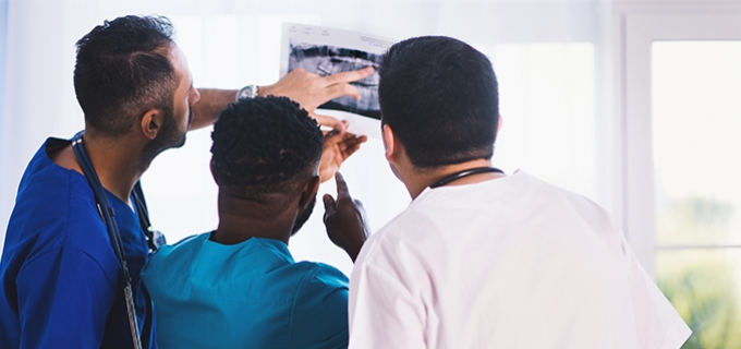 Healthcare workers looking at an X-ray